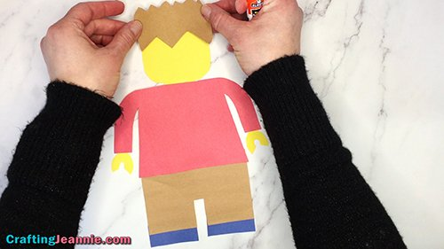 gluing on the paper lego minifigure hair