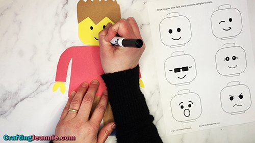 drawing the face on the paper lego craft