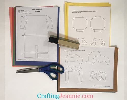 stapling the lego craft template to construction paper