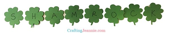 green paper clovers spelling out the word shamrock
