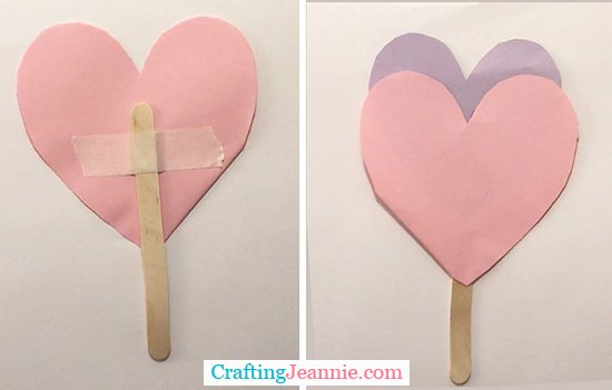 back of paper heart with popsicle stick taped and front of heart