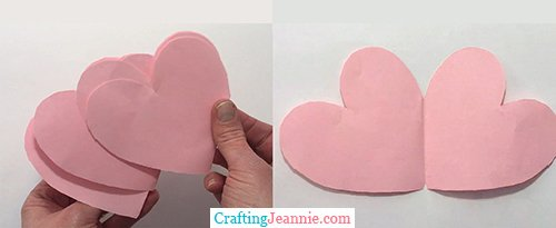 lots of pink hearts folded in the middle like cards
