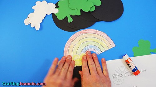glue the rainbow behind the coins