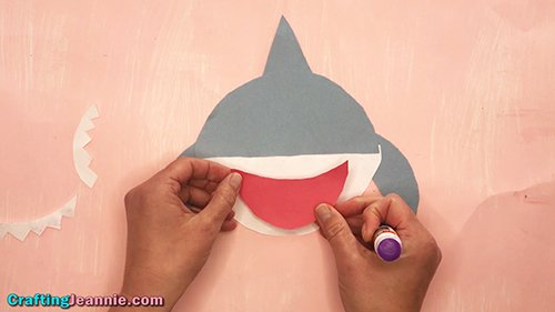 gluing on the paper shark mouth