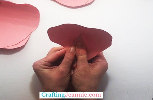 folding the rose petal over itself to make it 3-D