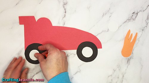 adding hubcaps to paper race car