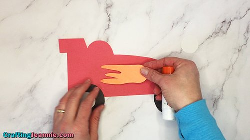 gluing on flame to paper race car