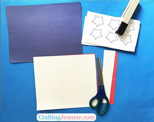 Flag Craft pieces, blue paper, white stars, and white and red strips
