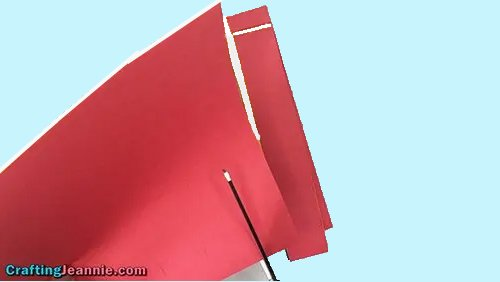 cutting out red and white strips of paper