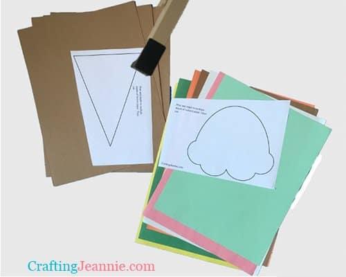 Ice cream craft template stapled to paper