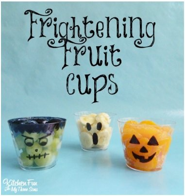 fruit cups with faces drawn on them as a halloween snack
