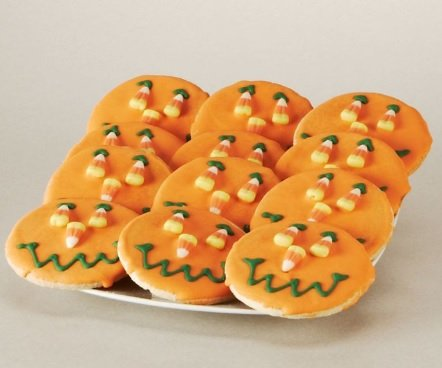 Halloween smile cookie with candy corn eyes and nose