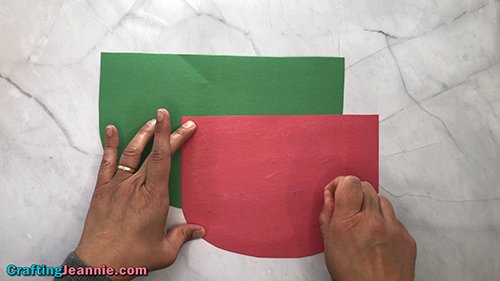 add glue to the red part of the preschool Watermelon craft