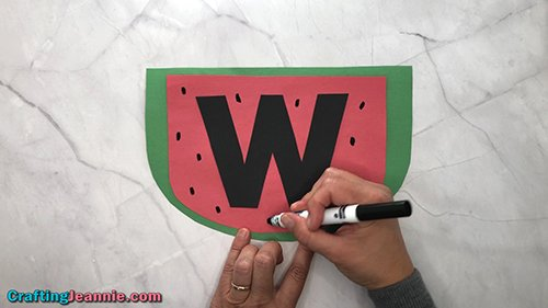 draw seeds onto the toddler Watermelon craft