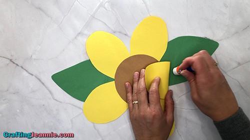 glue down the paper sunflower petals