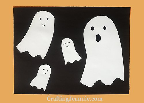 Paper ghost craft four white ghosts on black paper