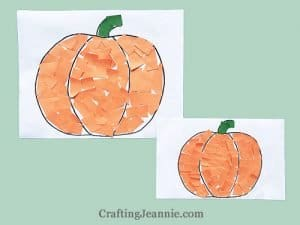 two scrap paper pumpkins - one large, one small
