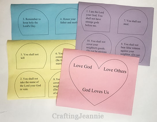 ten commandments printed on multiple sheets of colored paper