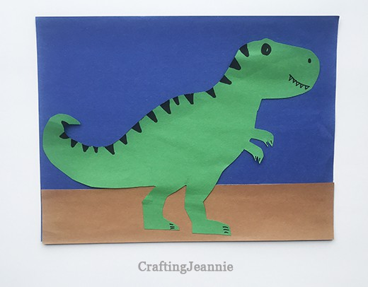 small trex on construction paper background