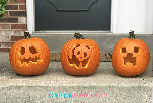 two carved minecraft pumpkins and a carved panda pumpkin