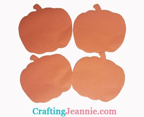 four paper pumpkins quickly cut out