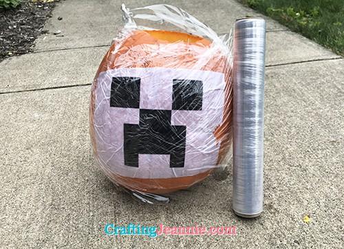 pumpkin wrapped in plastic wrap