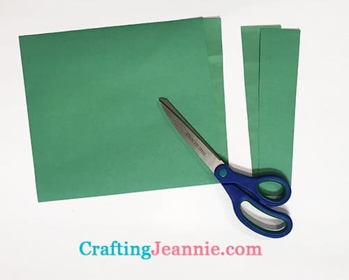 green rectangles cut out of multiple sheets of paper