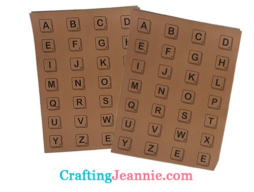 scrabble letters on brown paper