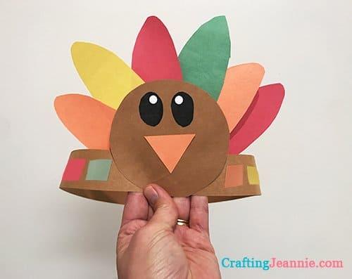 Hand holding turkey hat craft