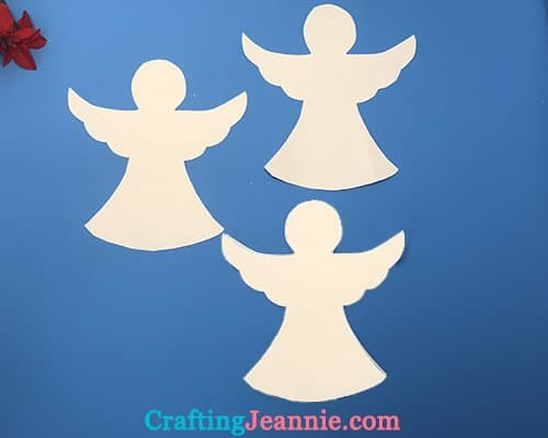 three angels cut from a template