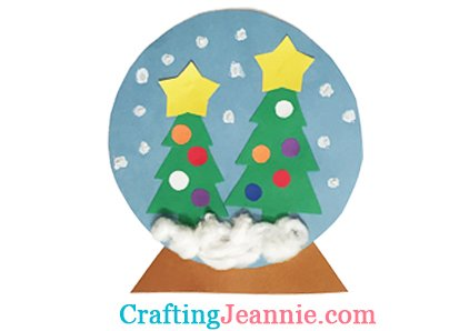 Two Christmas trees on blue paper to make a paper snow globe