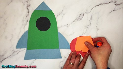 glue the orange flame to the red flame for the rocket craft