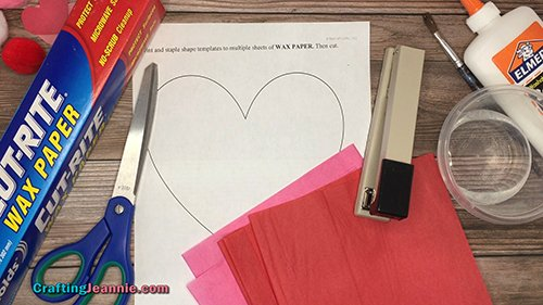 tissue paper, template, wax paper and supplies needed for heart sun catcher craft