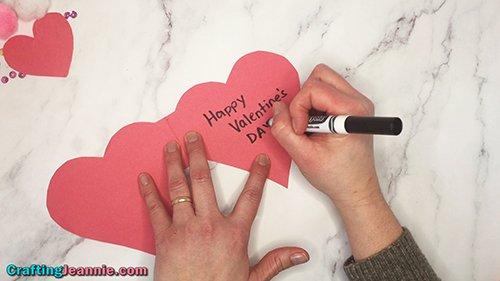 writing happy valentine's day inside card