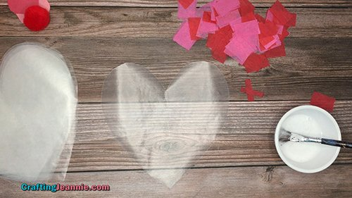 wax paper heart and lots of red tissue paper squares