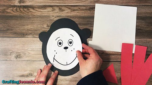 gluing the face onto the cat in the hat