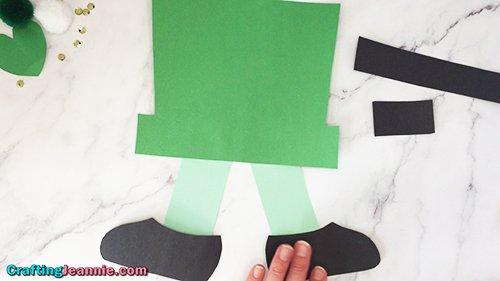 glue the shoes onto the easy leprechaun craft