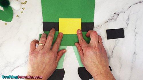 glue the yellow buckle onto the easy leprechaun craft