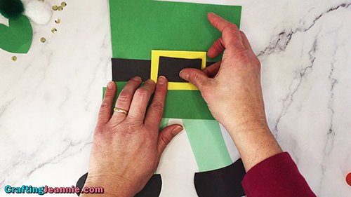 glue the black rectangle onto the yellow buckle of the easy leprechaun craft