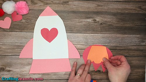 glue the orange flame onto the red flame of the Valentine Rocket Ship