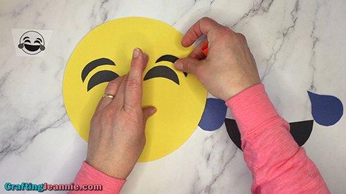 gluing on laughing emoji's eyes