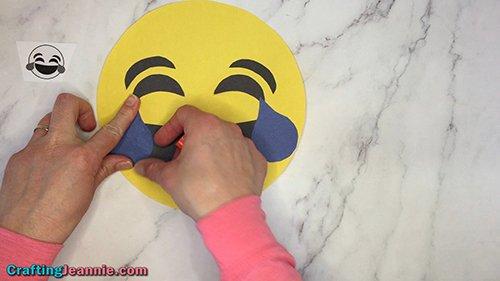 gluing on laughing emoji's tears