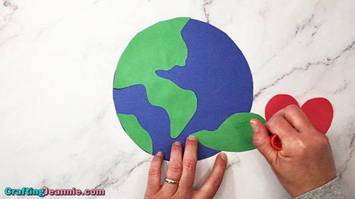 gluing final piece of land onto earth day craft - Crafting Jeannie