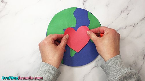 gluing heart onto earth day craft - Crafting Jeannie