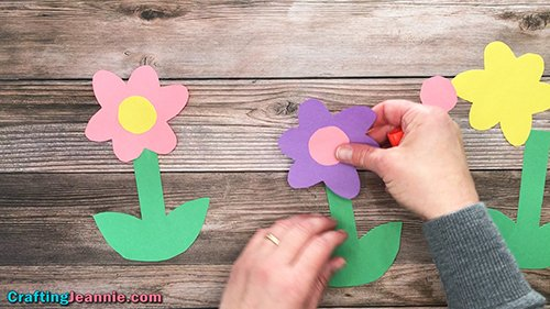 Daisy Craft - gluing paper flower onto the stem