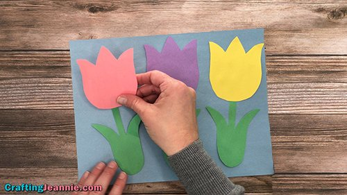 Tulip Craft - gluing paper tulips to background