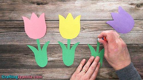 tulip craft - adding glue to paper tulip stem