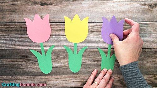 tulip craft - gluing paper tulip onto stem