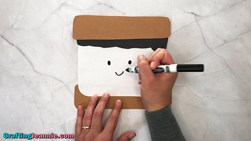 drawing face on Smores craft