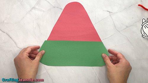 gluing the bottom onto the preschool Watermelon craft